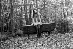 Outside girl in front of bench