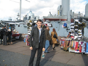 Market in front of warship