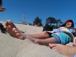 Feet in the sand on the beach