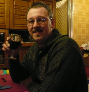 Guy with glasses drinking wine